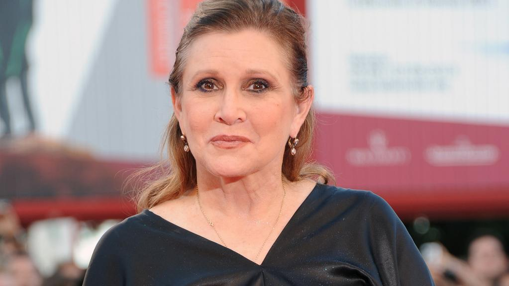 Carrie Fisher attends the 70th Venice International Film Festival at Sala Grande.