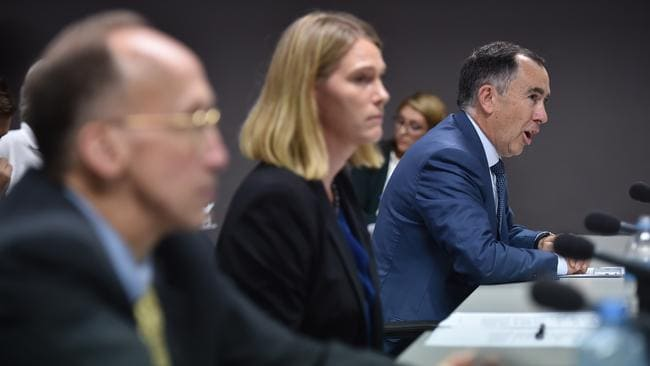 Corporate vice president of Apple Australia and New Zealand, Tony King, right, managing director of Google Australia Maile Carnegie, centre, and corporate vice president of Microsoft Bill Sample, left / Picture: AFP