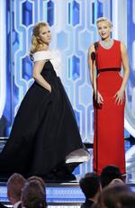 Amy Schumer and Jennifer Lawrence speak onstage during the 73rd Annual Golden Globe Awards at The Beverly Hilton. Picture: Getty