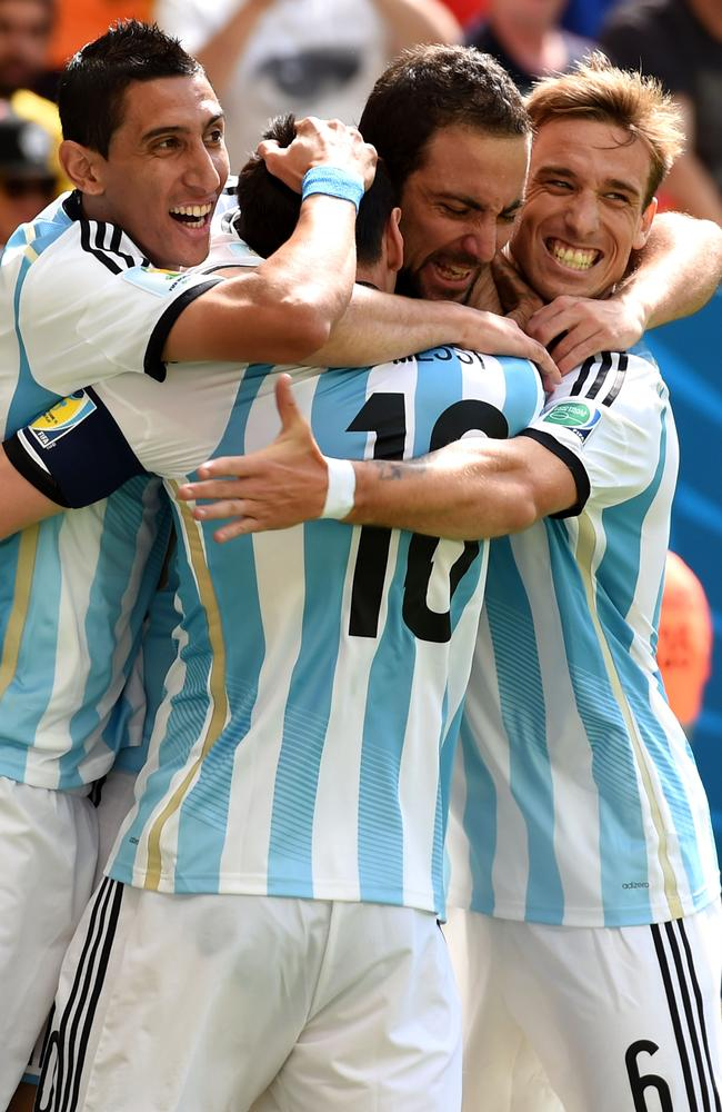 Argentina celebrates after scoring the opening goal against Belgium.