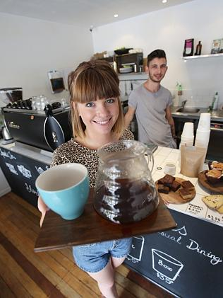 Mim Fergie and Jordan Lomas from Two Trees. Mr Lomas believes Brisbane residents may soon be paying $6 for a cup of coffee.