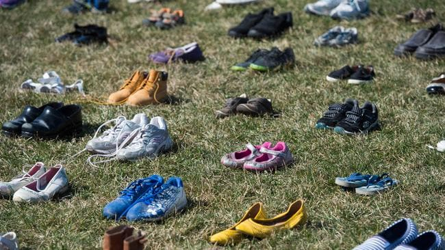 The shoes represent the 7000 children reportedly killed by gun violence since the Sandy Hook school shooting in 2012. Picture: AFP PHOTO / Saul Loeb
