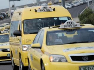 Taxis crawl across Melbourne's Bolte Bridge, causing peak hour chaos in a protest against a government licence buyback scheme. Monday, Feb. 13, 2017. Victorian Taxi and Hire Car Families urged cabbies to cause gridlock on the bridge to protest changes to the taxi industry after the introduction of ride-sharing.(AAP Image/Joe Castro) NO ARCHIVING