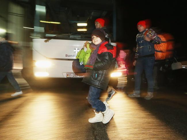 Migrants and refugees arrive from Austria at a processing centre in Passau, Germany. Picture: Getty