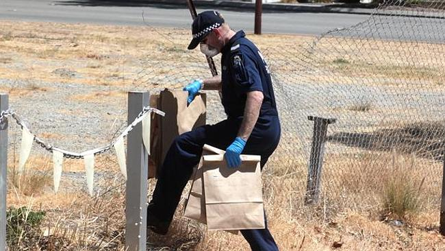 Officers comb Perth's Great Eastern Highway for evidence after a brawl involving up to 20 people — including children as young as seven — left a boy, 15, in a coma.