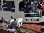 Passengers of a city ferry snap pictures of actor George Clooney and wife Amal Alamuddin as they leave in a boat after a civil wedding ceremony at the town hall in Venice, Italy on Monday, September 29th 2014. Picture: AP