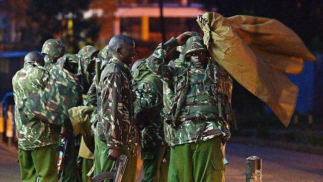 Kenyan police stand guard near Westgate mall in Nairobi. Picture: AFP /Carl de Souza