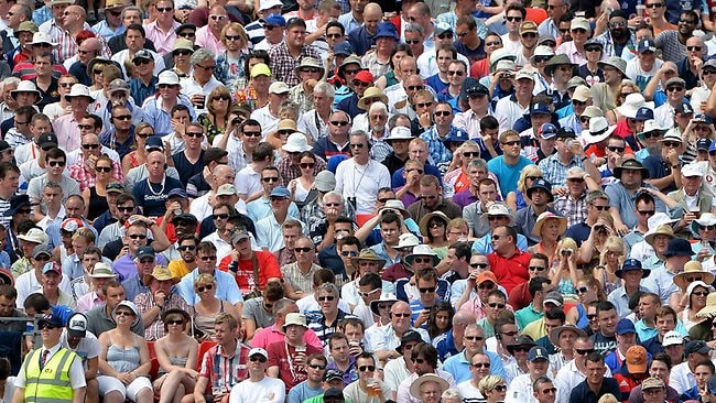 The crowd watch yesterday's play. AFP PHOTO/ANDREW YATES
