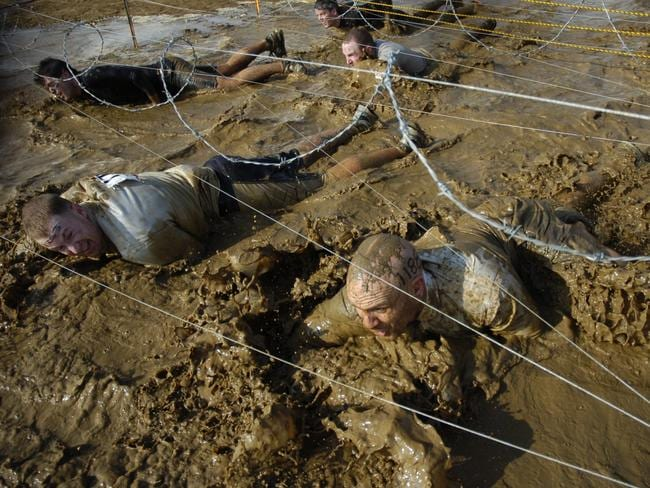 To the limits ... One of many gruelling tests, the above picture is from part of the SAS-designed Tough Mudder endurance course consisting of a 20km run as well as 20 obstacles and water crossings.
