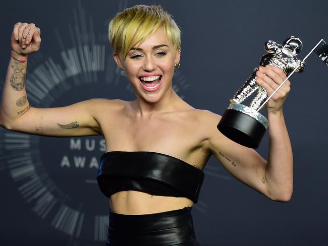 Singer Miley Cyrus poses in the press room during the MTV Video Music Awards (VMA), August 24, 2014 at the Nokia Theatre in downtown Los Angeles. Picture: AFP