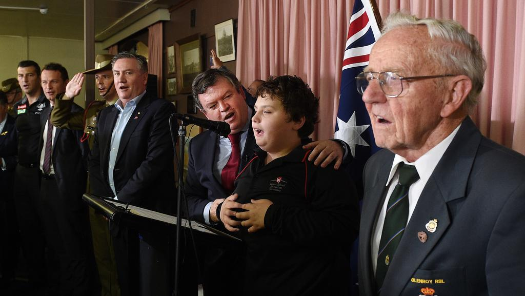 William, centre, singing the National Anthem with Broadmeadows state Labor MP Frank McGuire and brother Eddie in background at the Side By Side service at Maygar Barracks in the lead-up to Anzac Day.