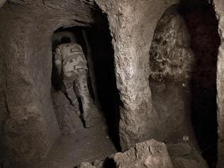 An Iraqi soldier walks inside one of the tunnels in east Mosul. Picture: AFP.
