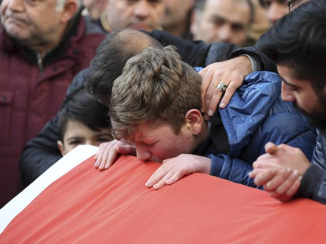 Family members and friends mourn as they attend funeral prayers for Ayhan Akin, one of the nightclub victims. Picture: AP