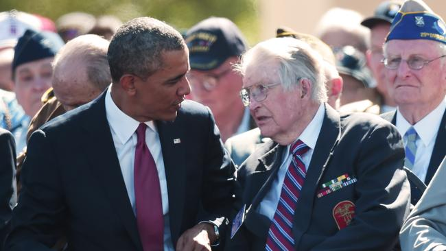 Honouring troops ... US President Barack Obama speaks with a US veteran during a joint French-US D-Day commemoration ceremony at the Normandy American Cemetery and Memorial in Colleville-sur-mer, Normandy. Picture: Damian Meyer