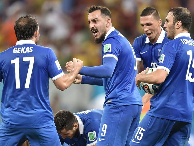 Greece's footballers celebrate the goal of defender Sokratis Papastathopoulos.
