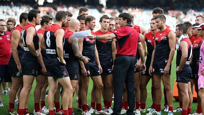 Paul Roos addresses the Demons at three quarter time. Picture Wayne Ludbey.