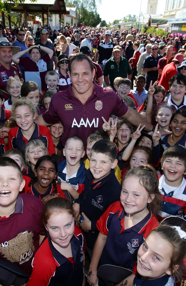 Maroon Matt Scott is swamped by local kids in the main street of Longreach during the fan day. Picture: Peter Wallis