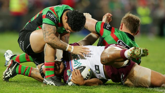 Manly's Steve Matai tackled by South Sydney's George Burgess and Issac Luke.