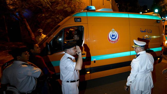 Tragic ... ambulances carrying the bodies of crash victims arrive at the Zeinhom Morgue in Cairo.