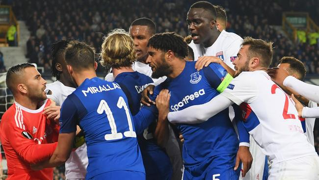 Ashley Williams of Everton (5) clashes with Lyon players after a challenge on Anthony Lopes.