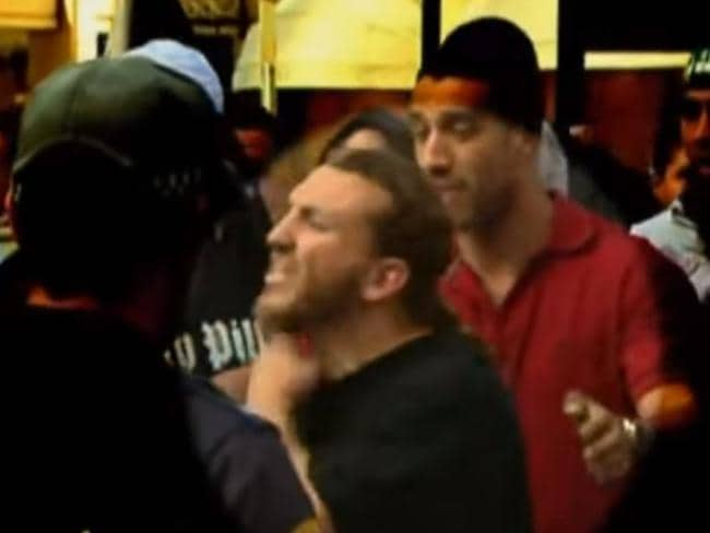 Ahmed Elomar gestures slitting his throat at police during the Hyde Park riots.