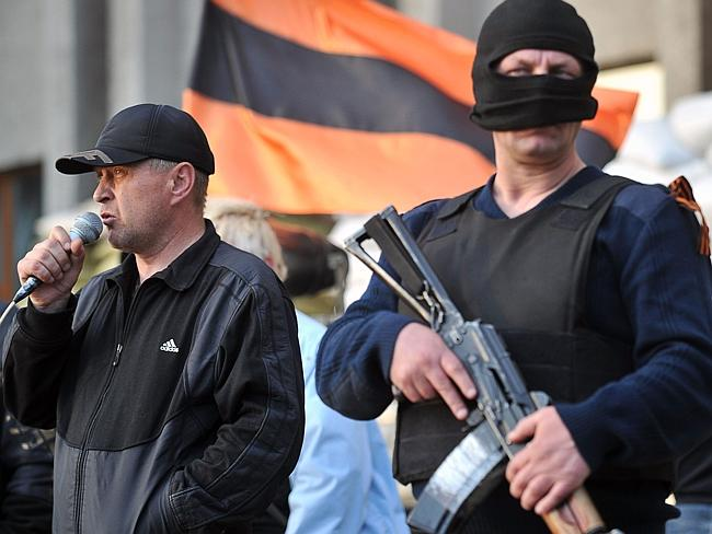 """Called on to leave ... one of the leaders of pro-Russian activists and the """"acting people's mayor"""" Vyacheslav Ponomaryov (left) during a rally in front of the regional state building seized by separatists in Slavyansk. Picture: Genya Savilov"""