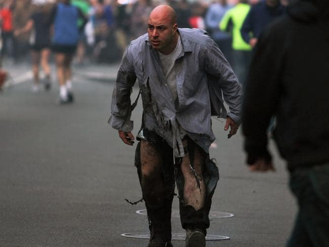 Attack ... Mr Costello pictured shortly after the Boston Marathon bombing. He was waiting with friends at the finish line when the bombs went off, killing three and injuring 260 people. Picture: AP