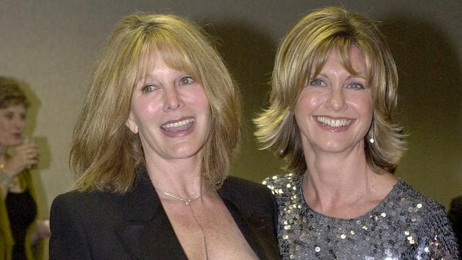 Newton-John (right) with her sister Rona Newton-John at a cocktail reception in 2001. Photo by Newsmakers
