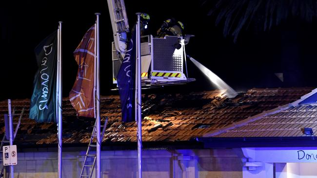 The fire was contained to the roof space, fire authorities say. Picture: Andy Brownbill