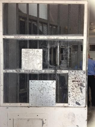 A damaged door at Don Dale Juvenile Detention Centre