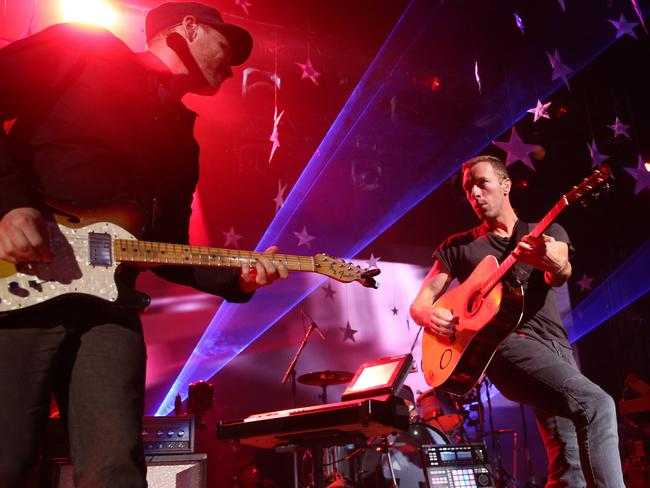 Rocking out ... British band Coldplay hold a concert at The Enmore Theatre as part of their Sydney 2014 tour. Picture: Richard Dobson