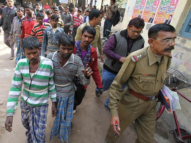 Suspects in a gang-rape case are led by police to a district courthouse. Indian police have arrested 13 people after a village woman was allegedly gang-raped on orders from tribal elders who objected to her relationship with a man. Picture: AFP