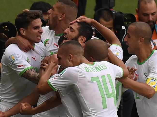 The Algerians celebrate one of their four goals (so far).
