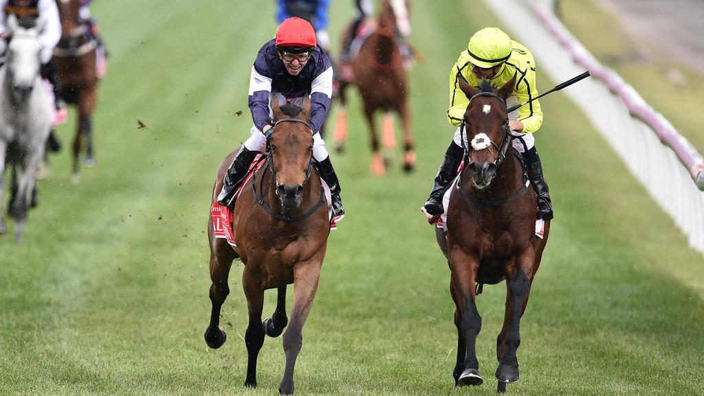 Kerrin McEvoy (left) rides Almandin to victory ahead of Heartbreak City ridden by Joao Moreira in the Melbourne Cup at Flemington Racecourse in Melbourne, Tuesday. Nov. 1, 2016. (AAP Image/Julian Smith) NO ARCHIVING, EDITORIAL USE ONLY