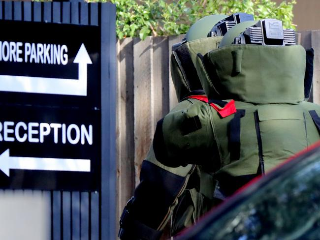 Bomb squad gearing up to head inside the Brighton apartment building where Khayre committed a terrorist act months after being released on parole. Picture: Alex Coppel.