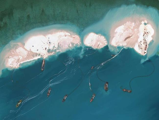 Great sand wall ... Chinese vessels dredging sand at Mischief Reef in the Spratly Islands. Source: AFP
