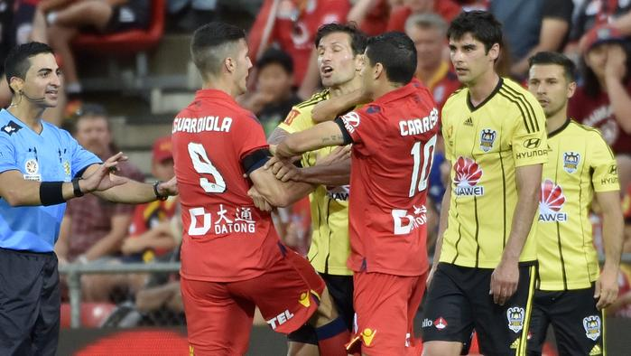 United's Sergio Guardiola (left) argues with Phoenix's Vince Lia (centre) during the Round 9 A-League match between Adelaide United and the Wellington Phoenix at Coopers Stadium in Adelaide, Sunday, Dec. 4, 2016. (AAP Image/David Mariuz) NO ARCHIVING, EDITORIAL USE ONLY