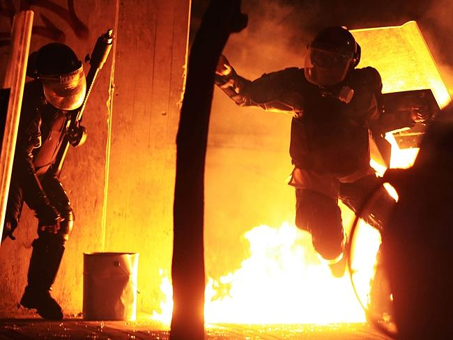 Police, protesters in fiery clash