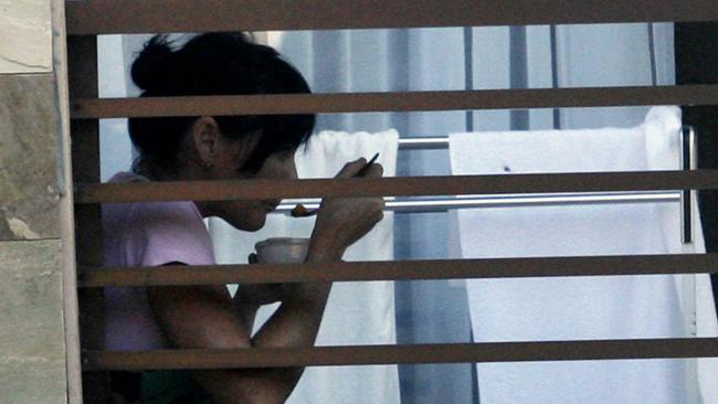 Convicted drug smuggler Schapelle Corby eats in her room at the Sanglah Hospital in Bali in 2008.