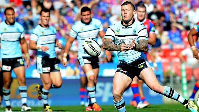 Todd Carney passes the ball during a clash between the Cronulla Sharks and Newcastle Knights at Hunter Stadium.