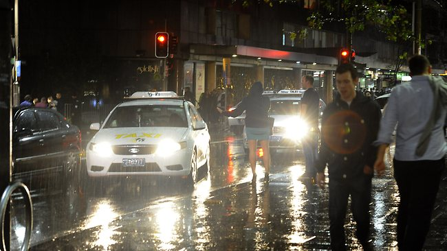 Getting a taxi when everyone else in the city is doing the same thing to avoid the rain can be quite a chore... probably should have brought along an umbrella. Picture: Gordon Mccomiskie