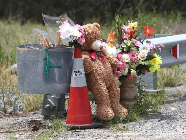 Flowers and tribute on the Pimpama bridge where the body of 12-year Tiahleigh Palmer was found. Photo: Regi Varghese