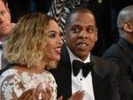 LOS ANGELES, CA - JANUARY 26: Singer Beyonce (L) and rapper Jay-Z during the 56th GRAMMY Awards at Staples Center on January 26, 2014 in Los Angeles, California. (Photo by Kevin Mazur/WireImage)
