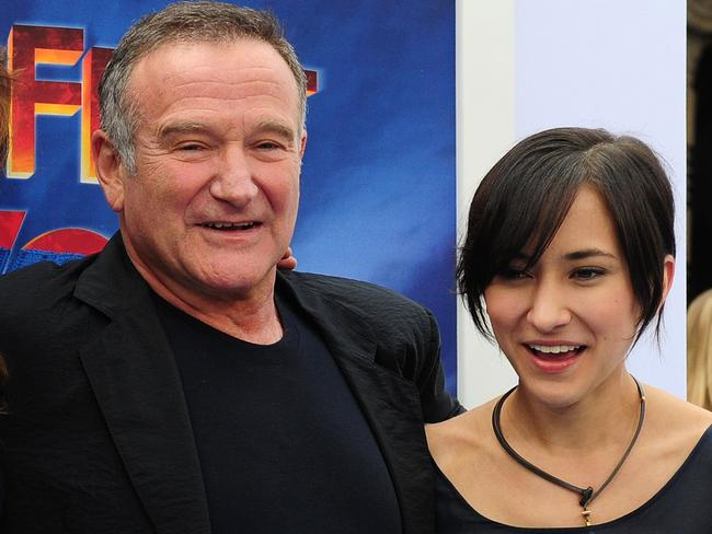 Disgraceful...Zelda Wiliams, with her later father at the Happy Feet Two premiere in Hollywood in 2011, has been forced off social media by cruel trolls. Picture: AFP
