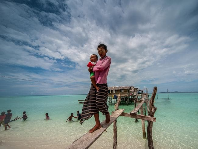 Along with their families, they live in wooden huts on stilts and trade their seafood for necessities with islanders in the nearby town of Semporna.