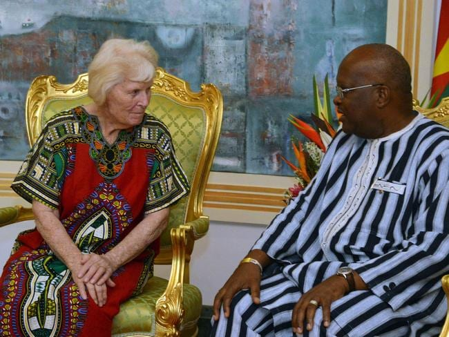 Freed hostage ... Jocelyn Elliott with Burkina Faso's president Roch Marc Christian Kobore at the presidential palace in Ouagadougou days after she was released. Picture: AFP/Ahemed Ouba