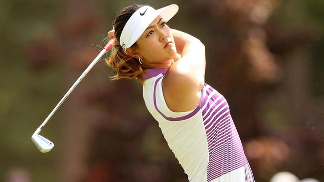 Michelle Wie of the United States hits a tee shot on the ninth hole during the third round.