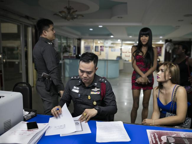 Sex workers are questioned by police after being arrested on July 30. Thailand's tourism minister has been waging a war on illegal tourism, including the sex tourism industry. Picture: Paula Bronstein/ Getty Images