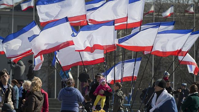 Tensions high ... pro-Russian demonstrators gather at a rally in Lenin Square, Simferopol.