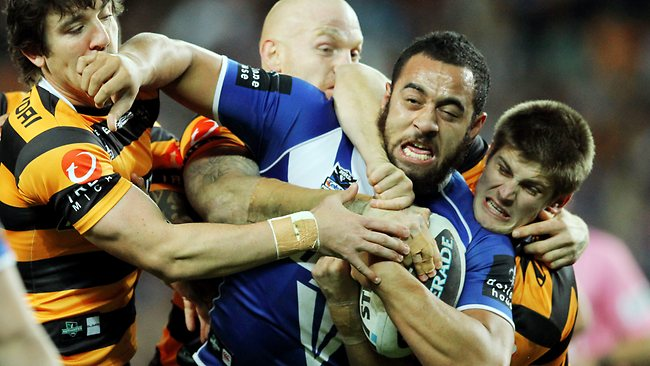 Sam Kasiano bullocks through the Wests Tigers defence. Picture: Mark Evans